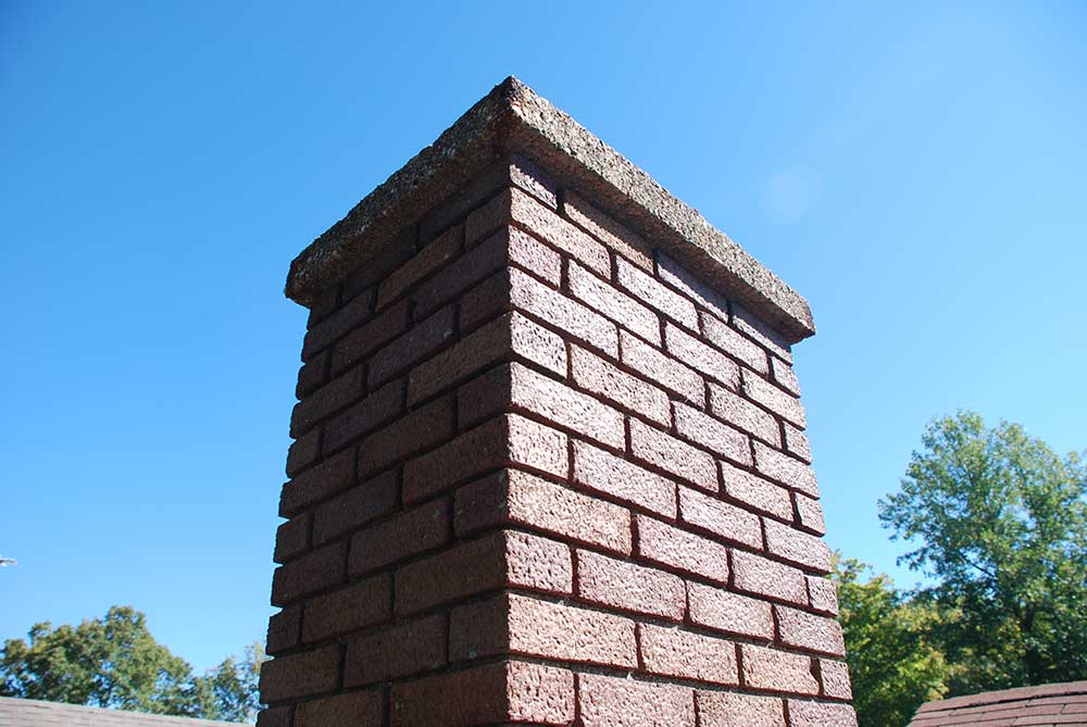This is made of stones, bricks, or reinforced concrete and is then lined with flue liners and built to code.